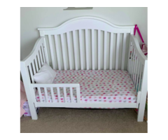 A Baby Crib Bed With The Mattress