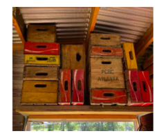 Antique Bottles Of Coke And Pepsi Cola Crates Signs